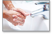 washing hands to clean bacteria